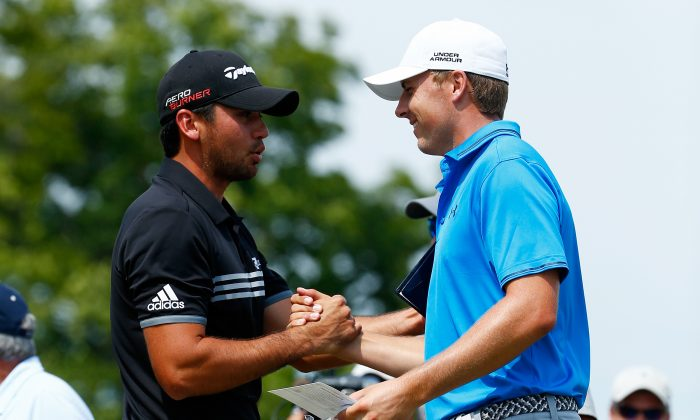 Jason Day of Australia (L) greets Jordan Spieth of the United States on the first tee during the final round of the 2015 PGA Championship at Whistling Straits on August 16, in Sheboygan, Wisconsin. (Jamie Squire/Getty Images)