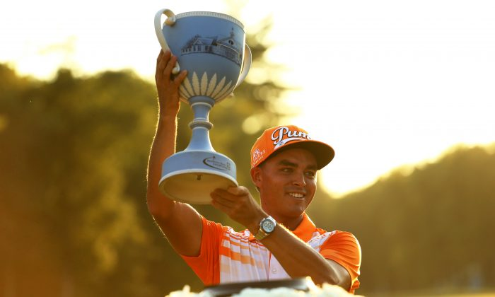Rickie Fowler raises the winners trophy at the Deutsche Bank Championship at TPC Boston on September 7, in Norton, Massachusetts. (Maddie Meyer/Getty Images)