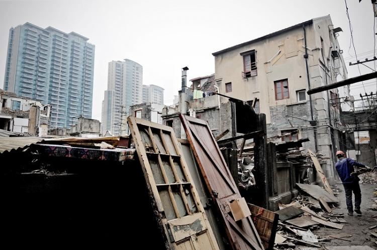 A property in Shanghai is being demolished to make way for new apartments.In 2009, the real estate market in China reached a state of frenzy with property prices rising tremendously (Getty)