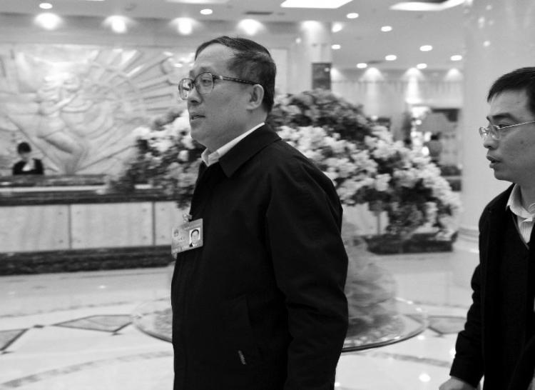 Hubei governor Li Hongzhong (left) (The Epoch Times)