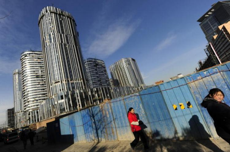 Despite the high vacancy rate, housing prices in Beijing have gone up 200 to 300 percent in the past year. The photo shows a construction site in Beijing on Dec. 16, 2009. (Getty Images)