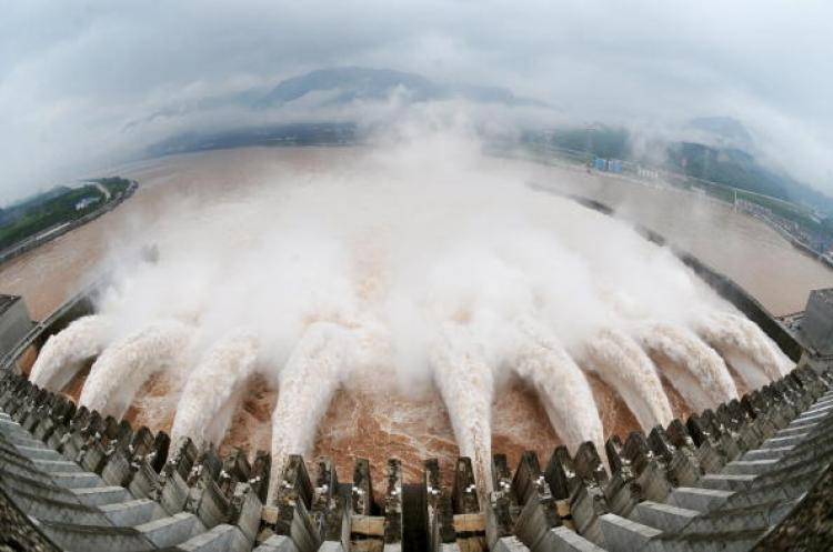 A picture shows this year's biggest release of water from the sluice for flood prevention at the Three Gorges Dam in Yichang, central China's Hubei province, on July 20, after relentless torrential rains hit Yangtze River areas. (AFP/AFP/Getty Images)