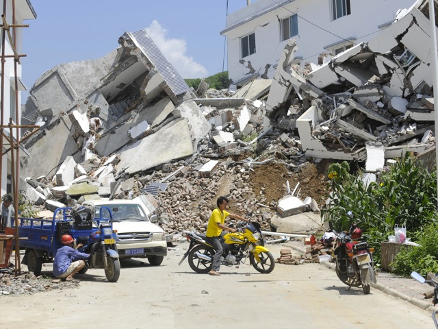 buildings destroyed by a flood-triggered landslide