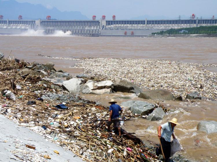 Workers clean up along the banks of the Yangtze River near the Three Gorges Dam in Yichang, in central China's Hubei province on August 1, 2010. (AFP/Getty Images)