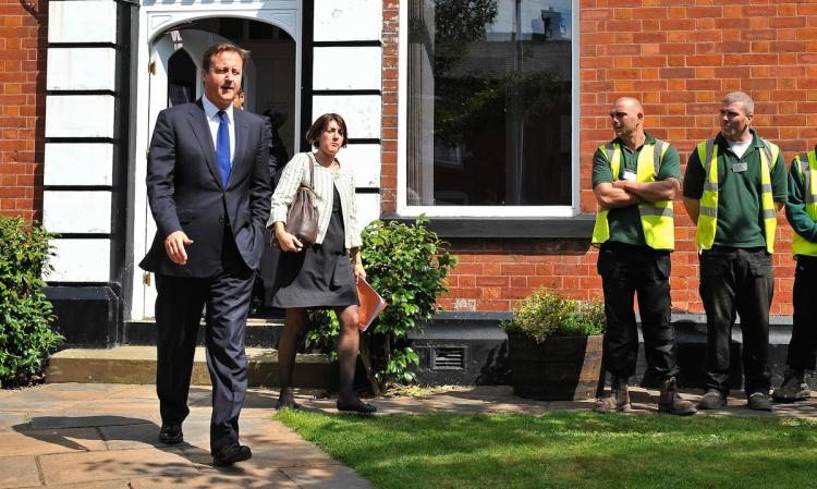 Prime Minister David Cameron visits community-based charity St Peter's Partnerships on August 10, in Ashton under Lyne, England. The prime minister unveiled a crackdown on benefit cheats using private credit reference agencies to detect fraudulent claims. (Bruce Adams - WPA/Getty Iamges)