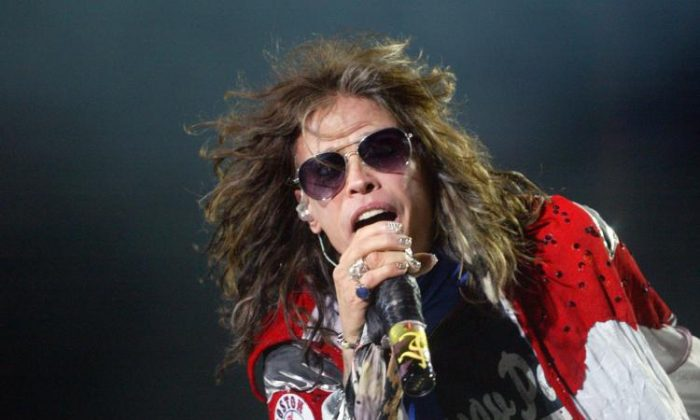 Steven Tyler of Aerosmith performs at Fenway Park on Aug. 14, 2010, in Boston, Mass. (John W. Ferguson/Getty Images)