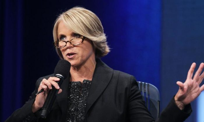 Katie Couric, anchor and managing editor of CBS Evening News, is photographed here speaking at a conference in New York City in September. (Mario Tama/Getty Images)