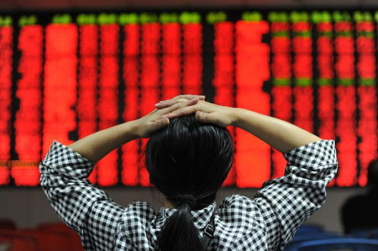Chinese investors monitor their stock prices at a security firm in Hefei, east China's Anhui province on October 14, 2010.  (AFP/Getty Images)