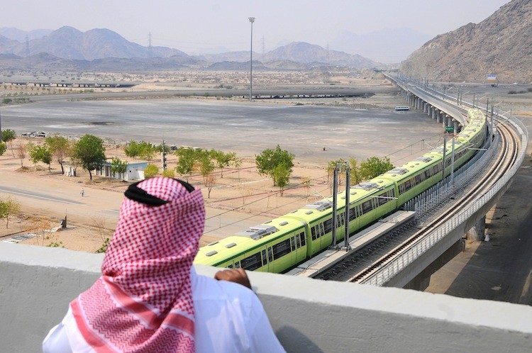 A man watches the Saudi Arabian Mecca Light Rail (MLR), a China Railway Construction Corporation (CRCC) project, in Saudi Arabia on November 2, 2010. To date the light rail has incurred losses amounting to 4.13 billion yuan (US$641.28 million) for the Chinese Government. (Amer Hilabi/AFP/Getty Images)