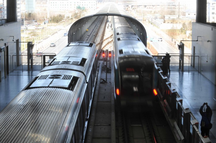 A subway train arrives at the newly completed Daxing subway station in Beijing last December 2010. China is now having a boom in subway construction; small or large, every other city is aspiring to build a rapid transit railway network. (STR/AFP/Getty)