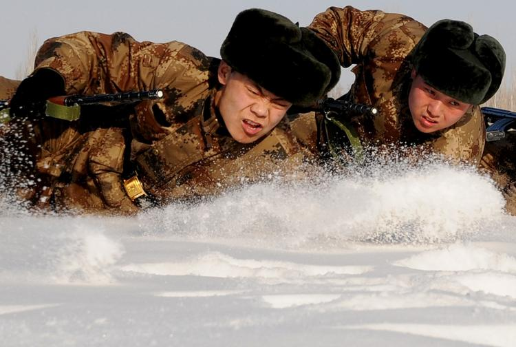 Chinese soldiers undergo a training session in Hami, northwest China's Xinjiang region on January 12, 2011.  (STR/Getty Images)
