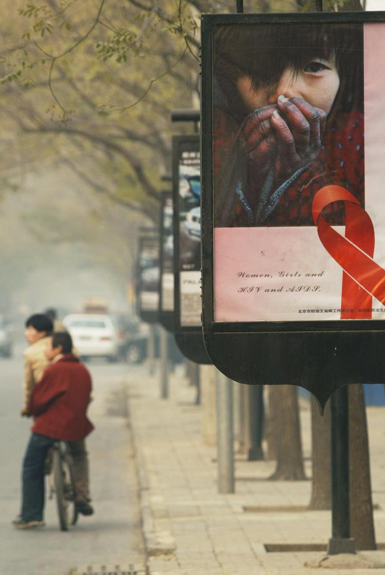 A poster to promote AIDS awareness ahead of World AIDS Day in Beijing. A highly contagious AIDS-like disease is spreading in China, However, HIV tests come up negative.