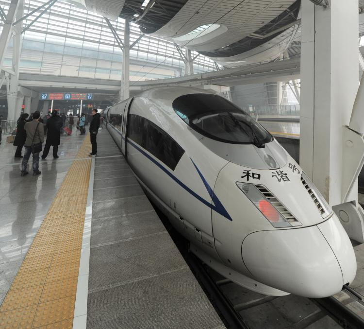 Passengers board a high-speed train at a railway station in Beijing on Feb. 21, 2011.  (AFP/Getty Images)