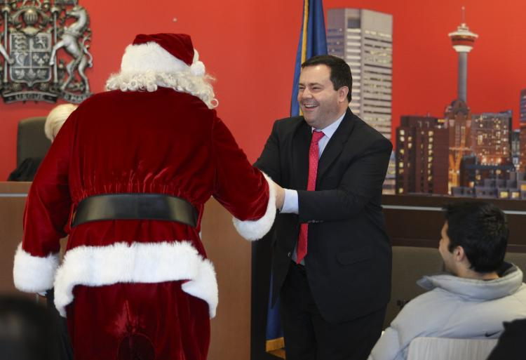 Citizenship and Immigration Minister Jason Kenney pulled Santa into the sovereignty issue during a special citizenship ceremony in Calgary on Wednesday. (Courtesy of Citizenship and Immigration Canada)