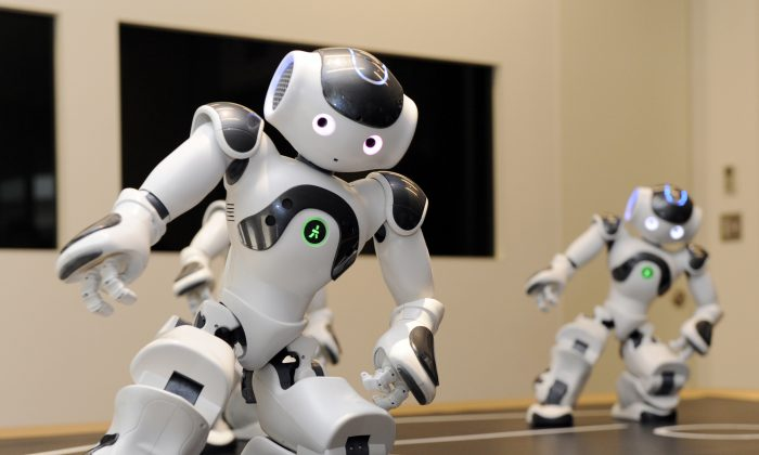 Humanoid robots called 'Nao' from the French robotics venture Aldebaran demonstrate their skills during a display at the French Embassy in Tokyo on October 13, 2010. (YOSHIKAZU TSUNO/AFP/Getty Images)
