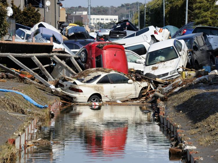 Vehicles block a canal after they were deposited there in Tagajo, Miyagi prefecture on March 13, 2011 following a massive earthquake and tsunami on March 11. (Toru Yamanaka/AFP/Getty Images)