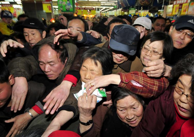 Chinese shoppers crowd a shop in an effort to buy salt in Lanzhou, northwest China's Gansu province on March 17. Chinese retailers reported panic buying of salt, partly because shoppers believe it could help ward off the effects of potential radioactivity from Japan's crippled nuclear power plant.   (STR/Getty Images)