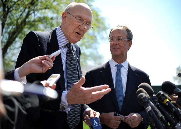 Democrat Erskine Bowles (R) and Republican Alan Simpson speak to reporters after a 2011 meeting with U.S. President Barack Obama at the White House in Washington, DC.