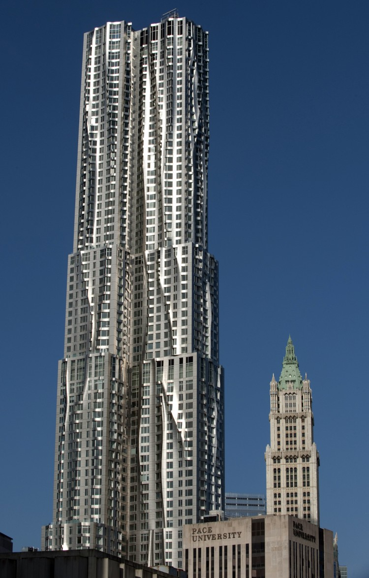 TOWERING OVER DOWNTOWN: New York by Gehry at 8 Spruce St., a recently opened skyscraper, is seen in front of the iconic Woolworth Building, on March 2. The 76-story modern tower is the tallest residential building in the Western Hemisphere. (Don Emmert/AFP/Getty Images)