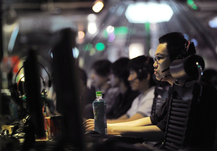 People at an internet cafe in Beijing, China in May 2011. China now has 485 million citizens capable of accessing the Web, more than any other country.  (Gou Yige/Getty Images )