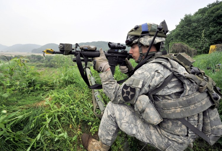 A US soldier takes a position during a joint military drill between South Korea and the US in Paju near the inter-Korean border on June 8, 2011. (Jung Yeon-Je/AFP/Getty Images)