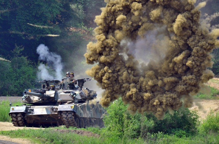 A South Korea's K1 tank fires smoke shells during a joint military drill between South Korea and the US in Paju near the inter-Korean border on June 8, 2011 aimed at deterring North Korea's military threat. (Jung Yeon-Je/AFP/Getty Images)