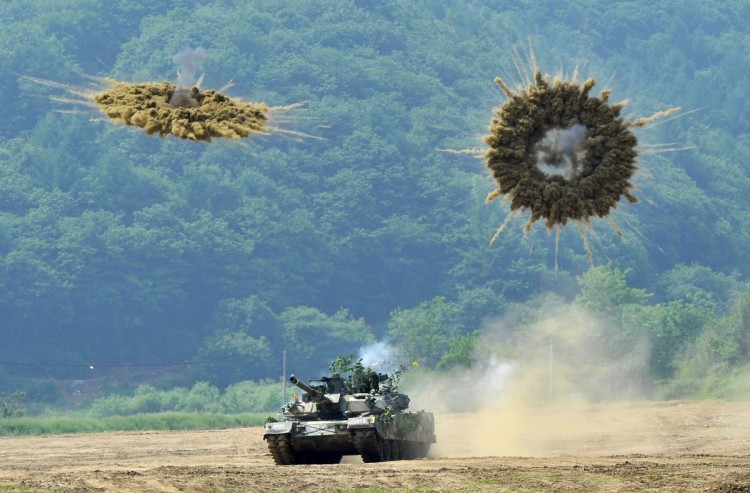 A South Korea's K1 tank fires smoke shells during a joint military drill between South Korea and the US in Paju near the inter-Korean border on June 8, 2011 (Jung Yeon-Je/AFP/Getty Images)