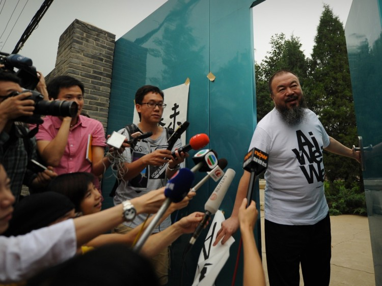 Outspoken Chinese artist Ai Weiwei arrives to speak to reporters outside his studio in Beijing on June 23. Weiwei has accepted a job to teach at the University of Berlin, but it's unclear whether he'll be allowed out of China. (Peter Parks/Getty Images)