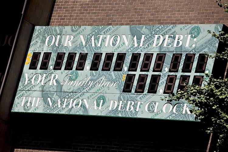 The U.S. National Debt Clock billboard is displayed on a building on Sixth Ave. in midtown Manhattan on July 11, 2011 in the New York City. (Ramin Talaie/Getty Images)