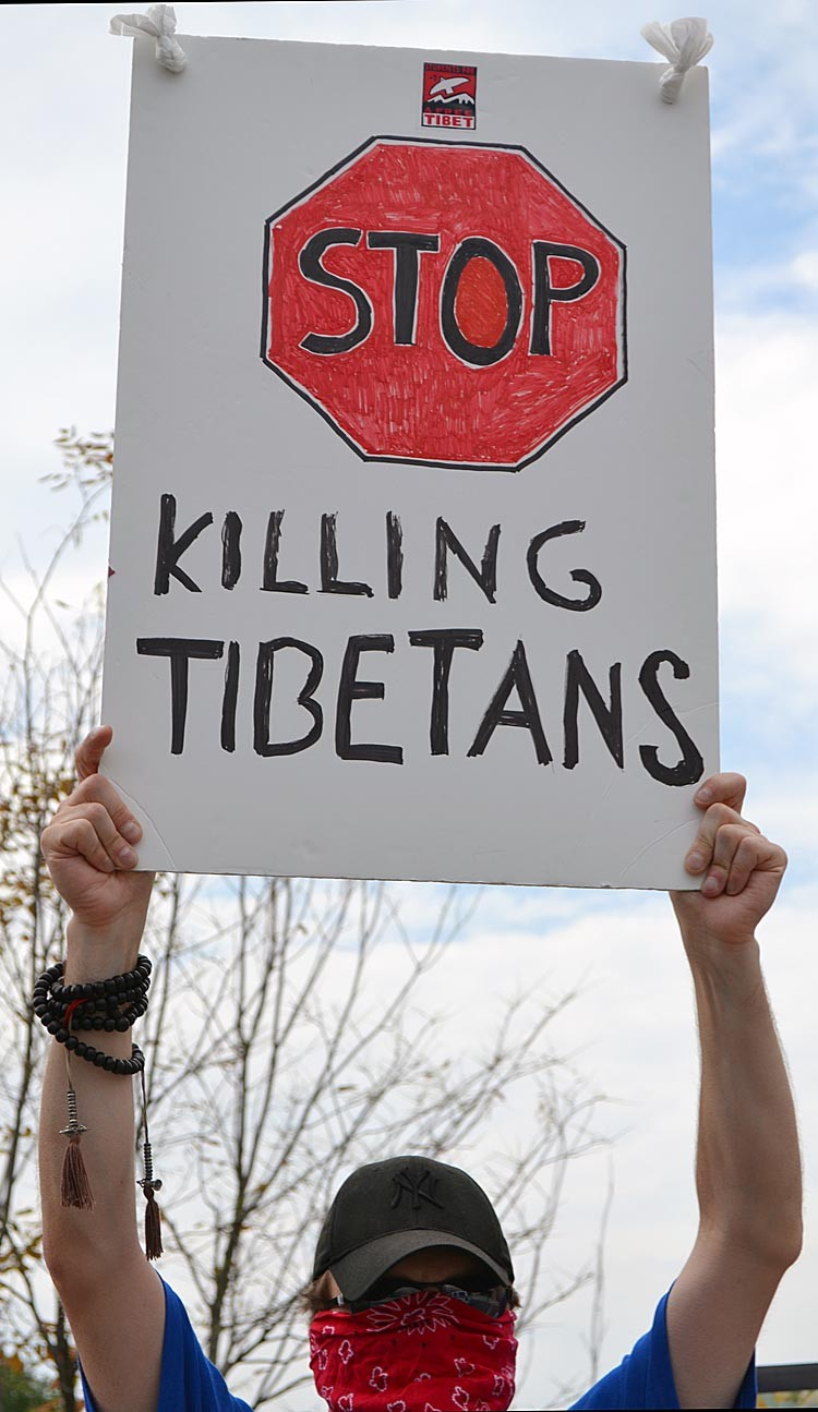 A protester holds a sign during the Tibetan protest in front of the Chinese Embassy in Washington, DC on July 13. The protest was held in opposition of the Chinese government's planned celebration of the 60 years of Chinese rule over Tibet, and was organized by the Students for a Free Tibet. (Hannah HOFFMAN/AFP/Getty Images)