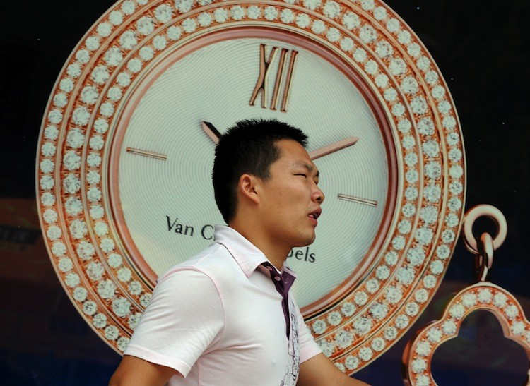 A man walks by a luxury watch store in the Wangfujing shopping street of Beijing on August 9. Luxury watches, far too expensive for Communist Party officials pay scales, can be a sure sign of corruption, writes a former CEO of a joint venture firm. (Mark Ralston/Getty Images)