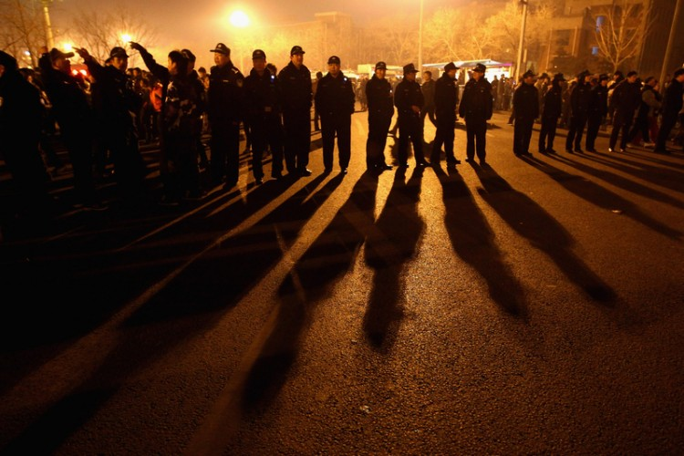 Chinese police blockade a road, Feb. 17, 2011.