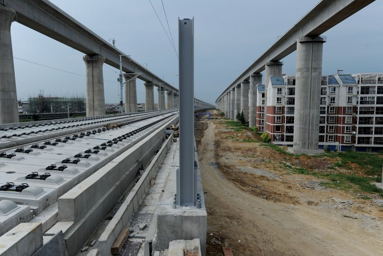 China has suspended all new railway construction projects, as controversy swirls over the nation's high-speed network nearly three weeks after a fatal crash sparked safety concerns.  (STR/AFP/Getty Images)