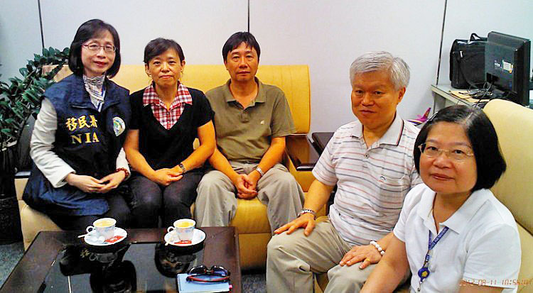 Chung Ting-pang (third from left) sitting with family after his release