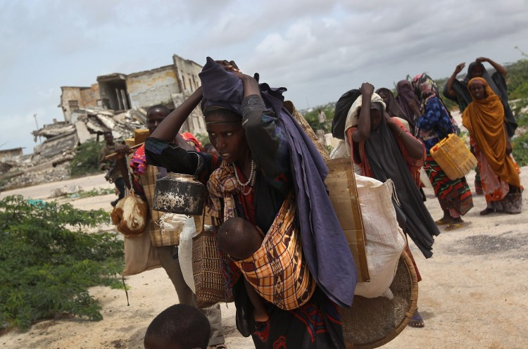 An extended family arrives at a makeshift camp for Somalis displaced by drought and famine on August 13, 2011 in Mogadishu, Somalia. (John Moore/Getty Images)