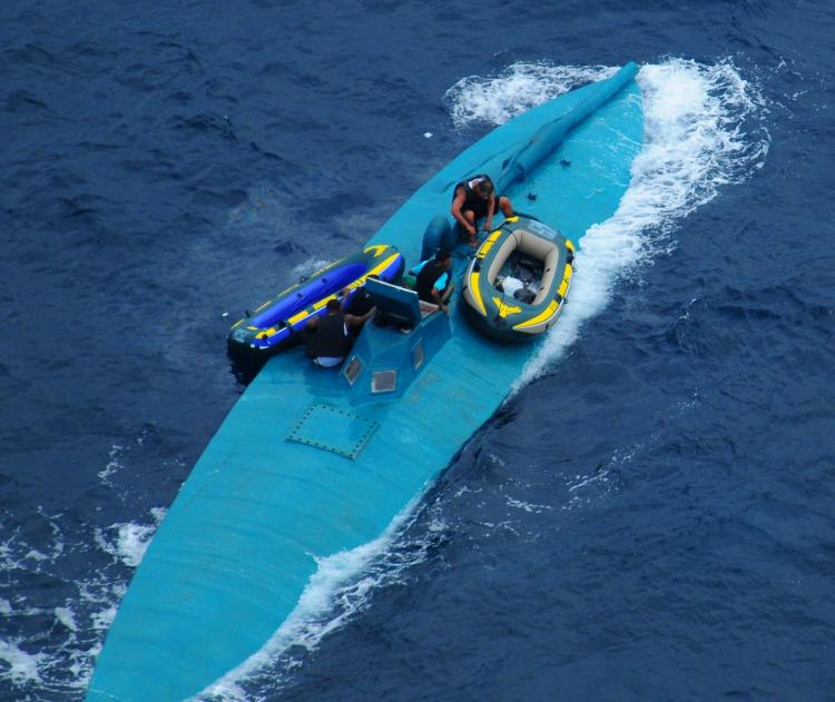 EASTERN PACIFIC DRUG BUST: The crew of a semi-submersible drug-trafficking vessel prepares to abandon ship before being intercepted by the U.S. Coast Guard northwest of the Colombian-Ecuador border on January 8. A dozen suspected drug smugglers were appre (U.S. Navy photo)