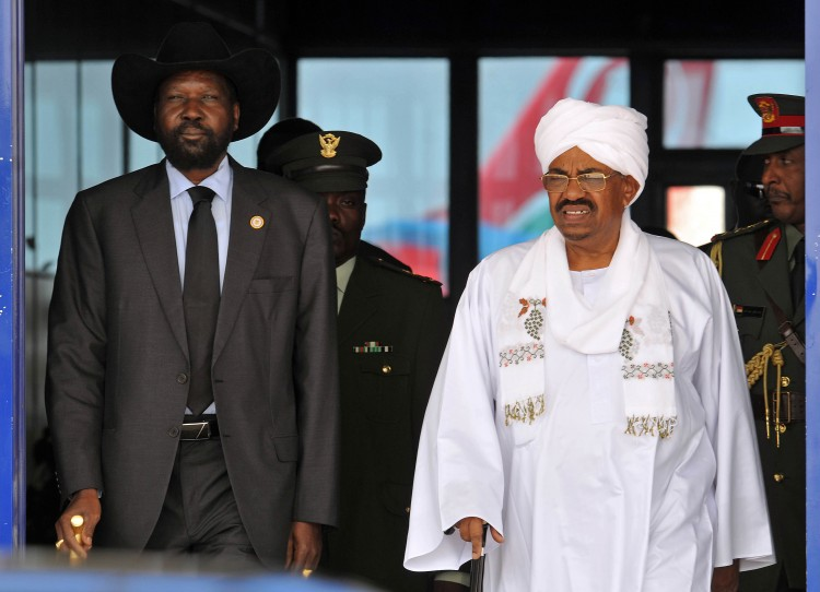 Sudanese President Omar Hassan Ahmad al-Bashir (R) greets his South Sudanese counterpart President Salva Kiir Mayardit on Oct. 8, 2011, upon the latter's arrival in Khartoum for his first visit after South Sudan's secession from Sudan. The two nations made nine agreements, but still have not implemented them and the conflict between the two, particularly centered on oil resources, could escalate. (EBRAHIM HAMID/AFP/Getty Images)