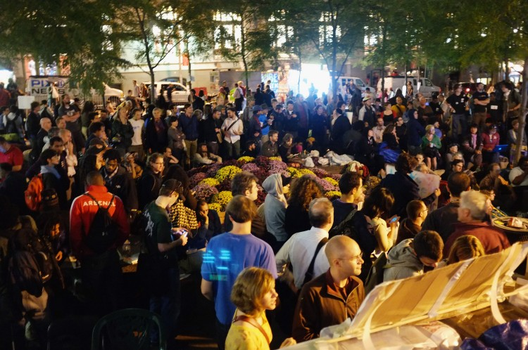 Wall Street protesters participate in a meeting at Zuccotti Park where hundreds of activists are living on Oct. 11 in New York City. (Spencer Platt/Getty Images)