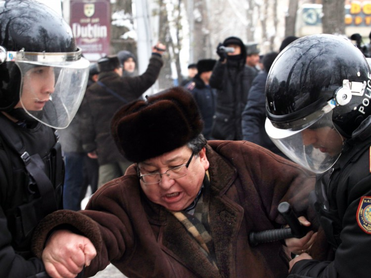 Kazakh riot policemen detain an opposition supporter during a rally in Almaty on December 17, 2011. (Anatoly Ustinenko/AFP/Getty Images)