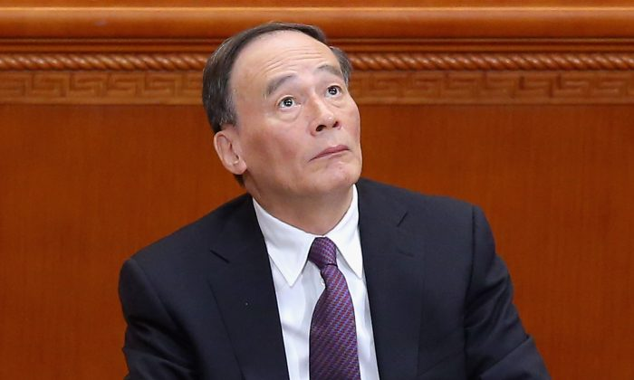 Secretary of the Central Commission for Discipline Inspection Wang Qishan attends the closing session of the Chinese People's Political Consultative Conference at the Great Hall of the People on March 13, 2015 in Beijing, China. (Feng Li/Getty Images)