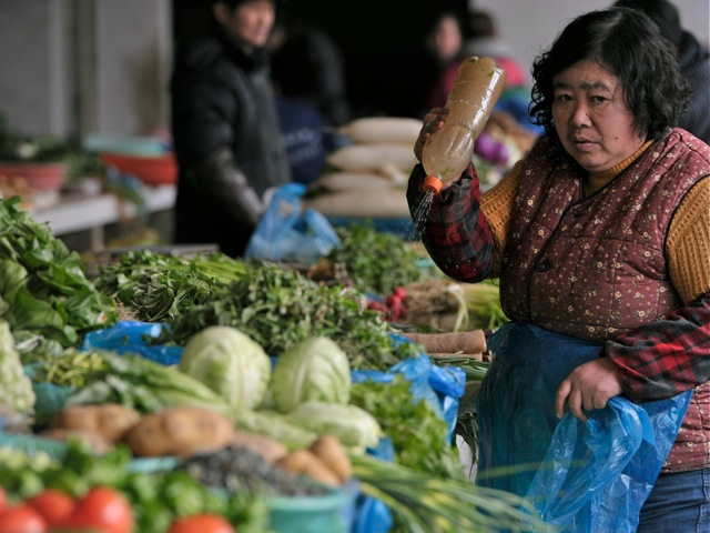 Venders sell vegetables in a market