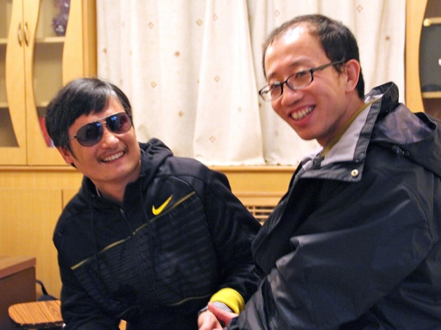 outspoken government critic Hu Jia (R) sharing a light moment with blind lawyer Chen Guangcheng