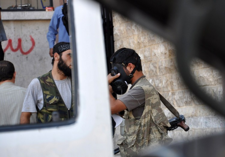 A Syrian opposition fighter tries a gasmask in the northern city of Aleppo on July 25, 2012. (Pierre Torres/AFP/GettyImages)