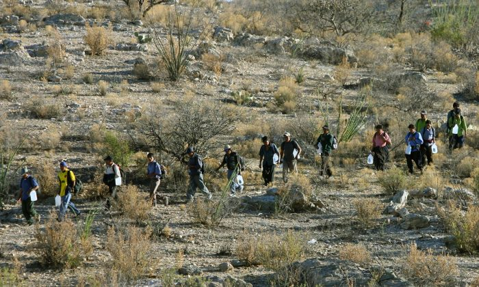 Mexican immigrants walk in line through the Arizona desert near Sasabe, Sonora State, Mexico, in an attempt to illegally cross the U.S.-Mexico border, on April 6, 2006. (Omar Torres/AFP/Getty Images)