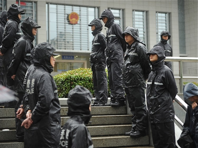 Police on guard outside the Intermediate People's Court in Hefei,