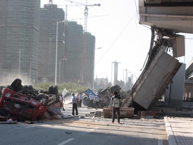 a collapsed eight-lane suspension bridge in Harbin