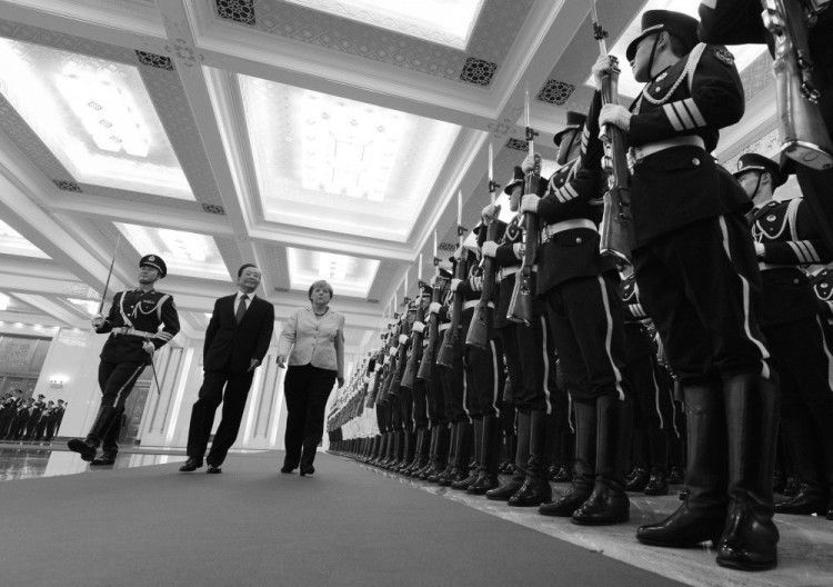 German Chancellor Angela Merkel (C) and Chinese Premier Wen Jiabao review an honor guard during her welcoming ceremony at the Great Hall of the People in Beijing on August 30, 2012.   (MARK RALSTON/AFP/GettyImages)