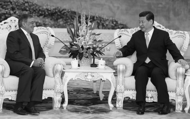 U.S. Secretary of Defense Leon Panetta sits with China's next communist leader Xi Jinping