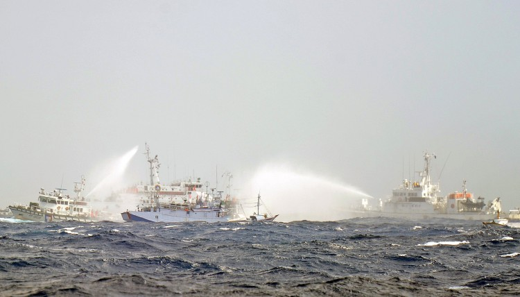 Japanese and Taiwan Coast Guard vessels use water cannon
