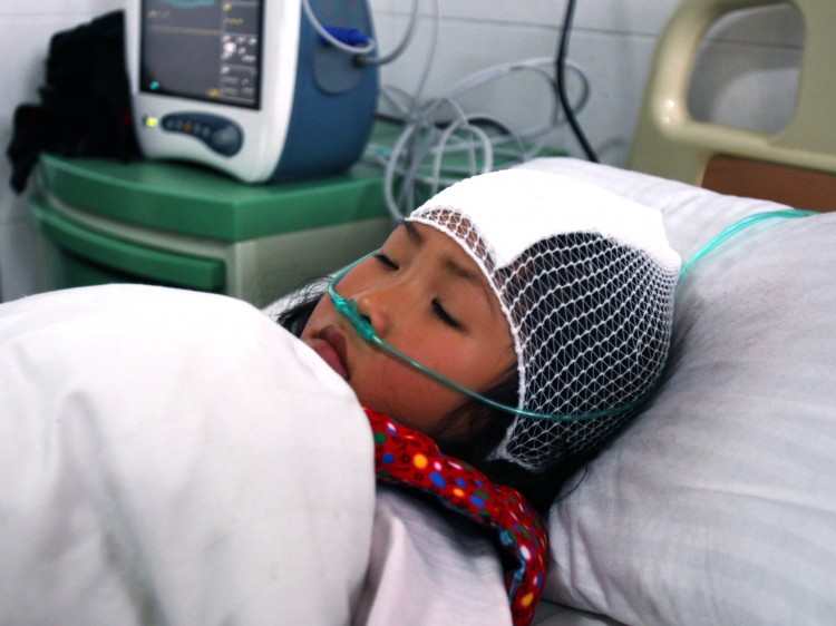 A girl lying on a hospital bed